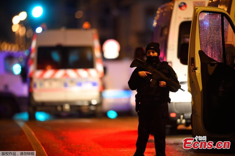 A policeman stands in the Neudorf area of Strasbourg, eastern France, after a shooting breakout, on December 11, 2018. (Photo/Agencies)