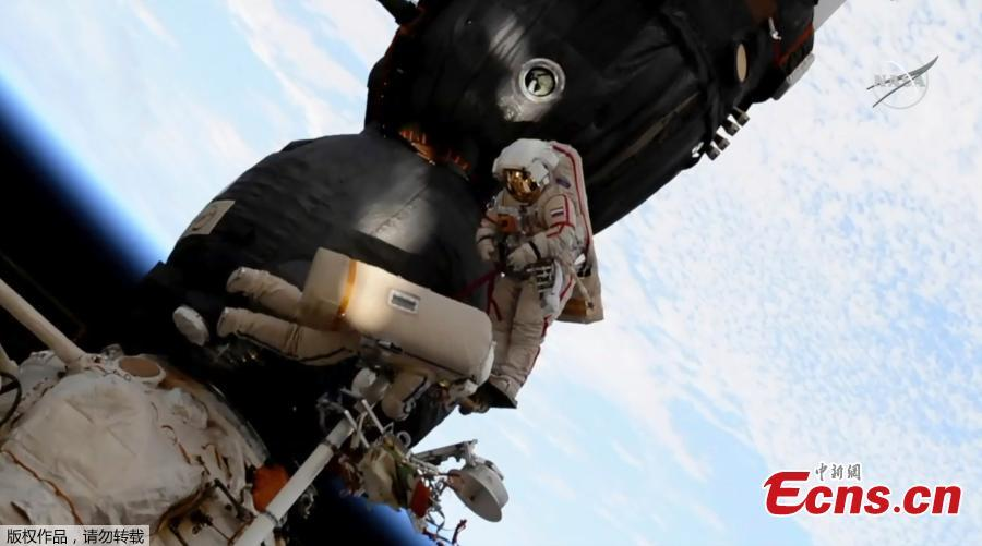 Two Russian cosmonauts have ventured outside the International Space Station today to inspect a section of a Russian spacecraft where a small hole was spotted. The mysterious leak was discovered on  August 30 in the Russian Soyuz craft which is attached to the ISS. It was initially believed to have been caused by a small meteorite and astronauts used tape to seal the leak after it caused a minor loss of pressure. Now, the two astronauts have confirmed the hole is safe - and the craft will be used again. (Photo/Agencies)