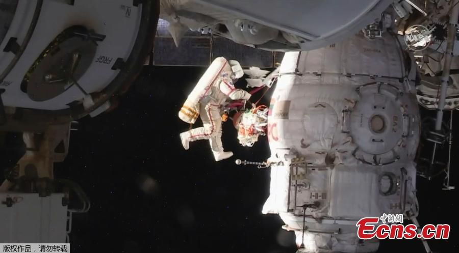 In this image from video made available by NASA, Russian cosmonauts Oleg Kononenko and Sergei Prokopyev perform a spacewalk outside the International Space Station on Tuesday, Dec. 11, 2018. (Photo/Agencies)