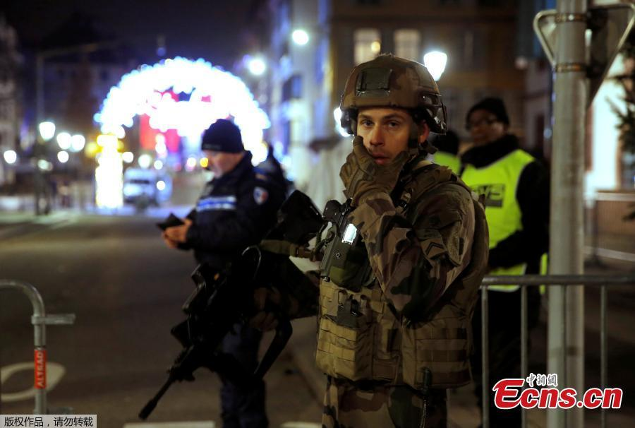 Police officers secure a street and the surrounding area after a shooting in Strasbourg, France, December 11, 2018. (Photo/Agencies)  The death toll of the shooting near a Christmas market in the French city of Strasbourg Tuesday evening has risen to four, several were wounded, local media reported. Security officers have cordoned off the area, while the injured were transported to a local hospital center. Interior Minister Christophe Castaner told reporters that several of the wounded were in critical condition and that he was heading to Strasbourg. According to sources from local authorities, the suspected gunman identified as 29-year-old and known to police for criminal activity, has been cornered. Police had reportedly exchanged gunfire with the suspect during the chase.