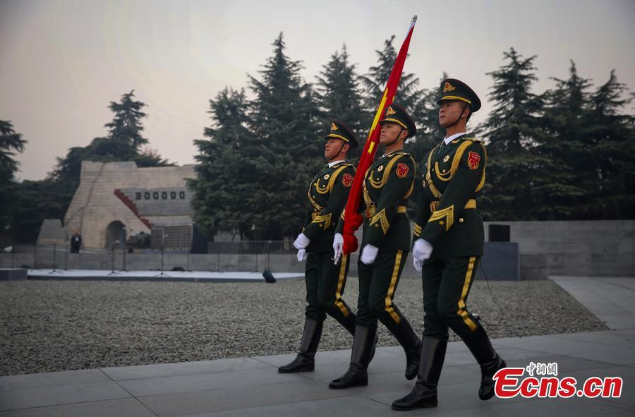 Photo taken on Dec. 13, 2018 shows the scene of the National Memorial Day for Nanjing Massacre Victims at the Memorial Hall of the Victims in Nanjing Massacre by Japanese Invaders in Nanjing City, Jiangsu Province. On Thursday, China marked the fifth national memorial day to commemorate the victims of the Nanjing Massacre, in which Japanese invaders slaughtered about 300,000 Chinese during a six-week rampage after they captured the city, then China\'s capital, in 1937. In front of the darkly-dressed crowd at the ceremony, China\'s national flag is flown at half-mast. In February 2014, China\'s top legislature designated December 13 as the National Memorial Day for Nanjing Massacre Victims. (Photo: China News Service/Yang Bo)