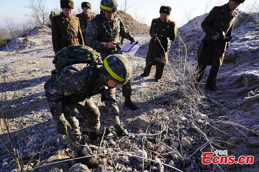 In this photo provided by South Korea Defense Ministry, South Korean army soldiers, wearing helmets, inspect at the dismantled North Korean guard post inside the Demilitarized Zone (DMZ) in the central section of the inter-Korean border in Cheorwon, Dec. 12, 2018. Dozens of soldiers from two countries crossed over the world\'s most heavily armed border Wednesday as they inspected the sites of their rival\'s front-line guard posts to verify they\'d been removed. (Photo provided by South Korea Defense Ministry)