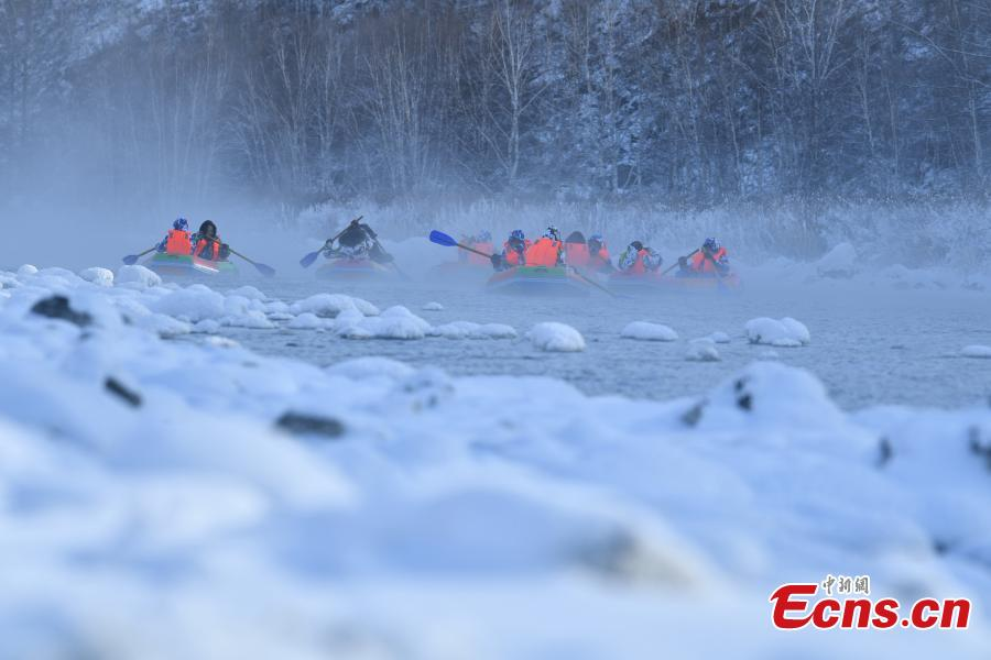 Hardy adventurers raft on a river nicknamed the \