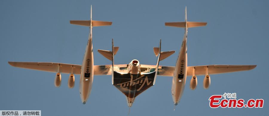 Virgin Galactic\'s SpaceshipTwo takes off for a suborbital test flight of the VSS Unity on December 13, 2018, in Mojave, California. - Virgin Galactic marked a major milestone on Thursday as Unity made it to a peak height, or apogee, of 51.4 miles (82.7 kilometers), after taking off attached to an airplane from Mojave, California, then firing its rocket motors to reach new heights. (Photo/Agencies)