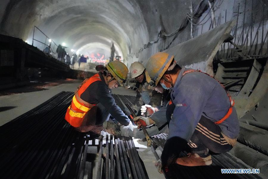 Workers build the New Badaling tunnel of the Beijing-Zhangjiakou high-speed rail line in Beijing, capital of China, Dec. 13, 2018. Workers have achieved a major breakthrough in the Beijing-Zhangjiakou high-speed rail line project, after they dug through the New Badaling tunnel, a pivotal part along the line, on Thursday. (Xinhua/Xing Guangli)