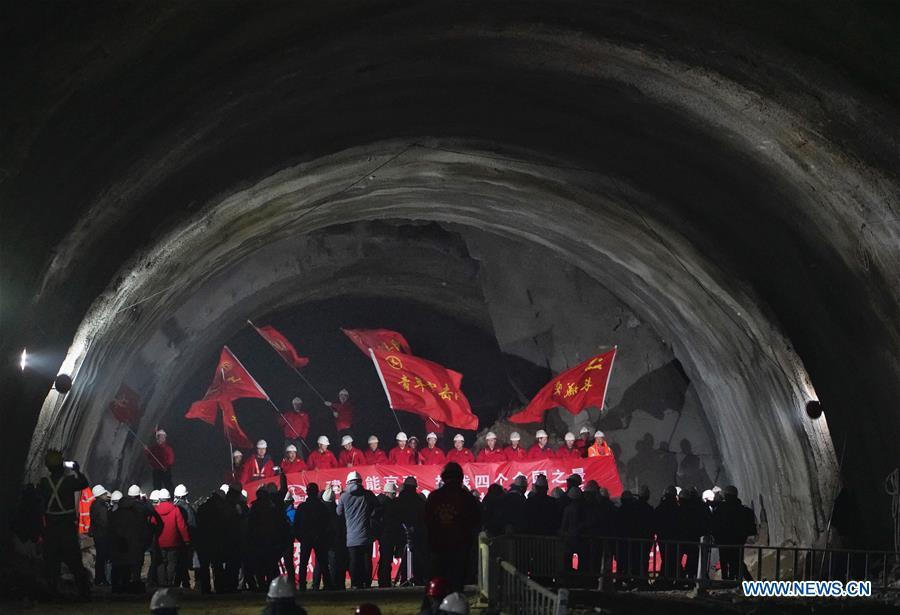 Workers celebrate as they cut through the New Badaling tunnel of the Beijing-Zhangjiakou high-speed rail line in Beijing, capital of China, Dec. 13, 2018. Workers have achieved a major breakthrough in the Beijing-Zhangjiakou high-speed rail line project, after they dug through the New Badaling tunnel, a pivotal part along the line, on Thursday. (Xinhua/Xing Guangli)