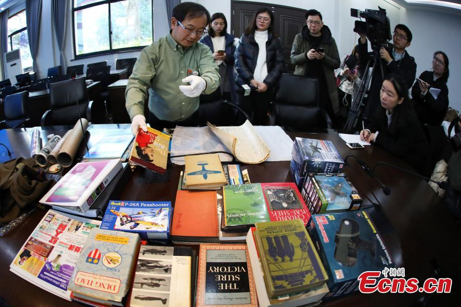 Chinese-American Lu Zhaoning donates historical materials to the Memorial Hall of the Aviator Martyrs in the War of Resistance against Japanese Aggression in Nanjing City, Jiangsu Province, Dec. 14, 2018. The relics included pilot's suits, books by Flying Tiger pilots and other materials about WWII war planes. Lu's relative Lu Meiyin served as a flight attendant in the war. The memorial hall shows the names and a basic introduction in Chinese, English and Russian on thousands of pilots from China, the United States and Soviet Union who died in China during the war. (Photo: China News Service/Yang Bo)