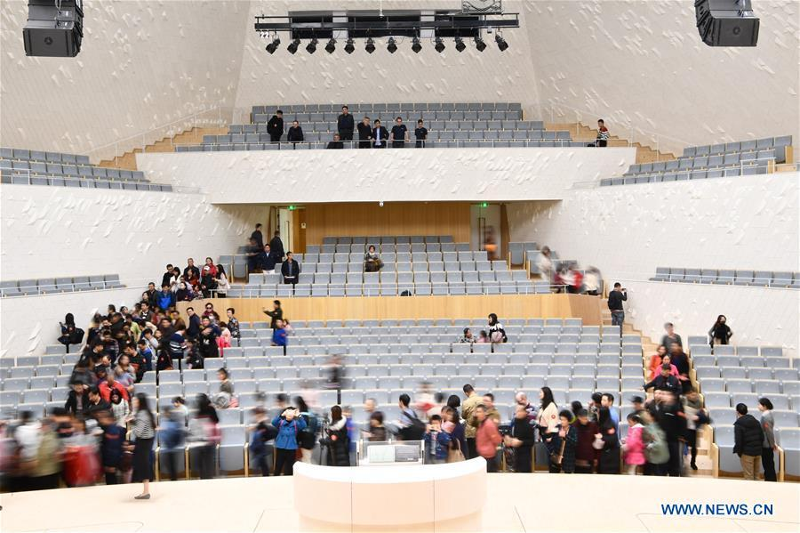 Citizens visit the concert hall of the Fuzhou Strait Cultural Art Center in Fuzhou, southeast China\'s Fujian Province, Dec. 16, 2018. The center held open day activities on Sunday. (Xinhua/Jiang Kehong)