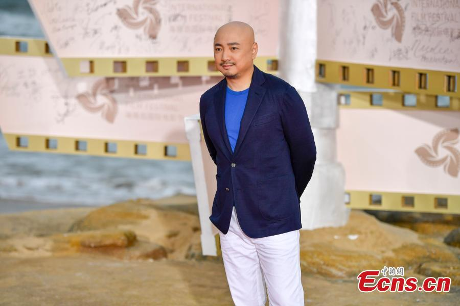 Actor and director Xu Zheng arrives for the first Hainan International Film Festival in Sanya City, Hainan Province, Dec. 16, 2018. The film festival is one of a series of events in Hainan as the city seeks to build itself into a pilot free trade zone and a free trade port. (Photo: China News Service/Luo Yunfei)