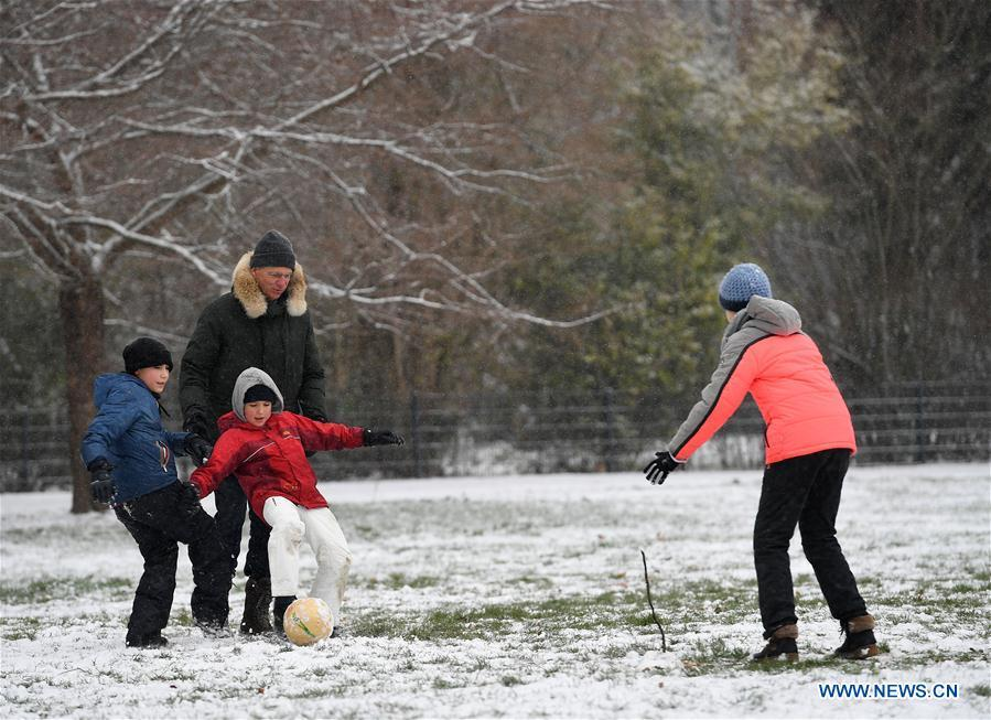 People play soccer at the snow-covered Grueneburg Park in Frankfurt, Germany, on Dec. 16, 2018. A snowfall hit Frankfurt on Sunday. (Xinhua/Lu Yang)