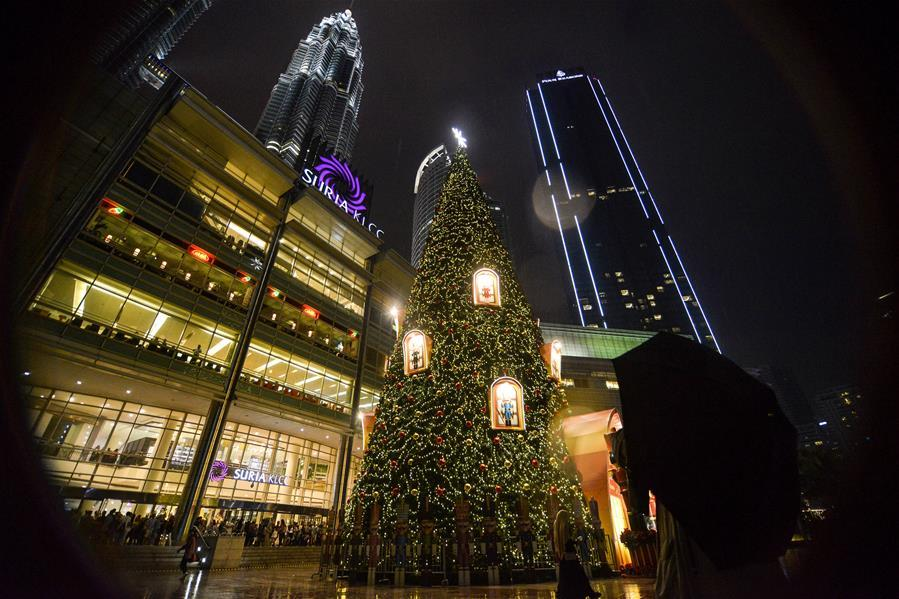 An illuminated Christmas tree is pictured outside a shopping mall in Kuala Lumpur, Malaysia, on Dec. 16, 2018. (Xinhua/Chong Voon Chung)