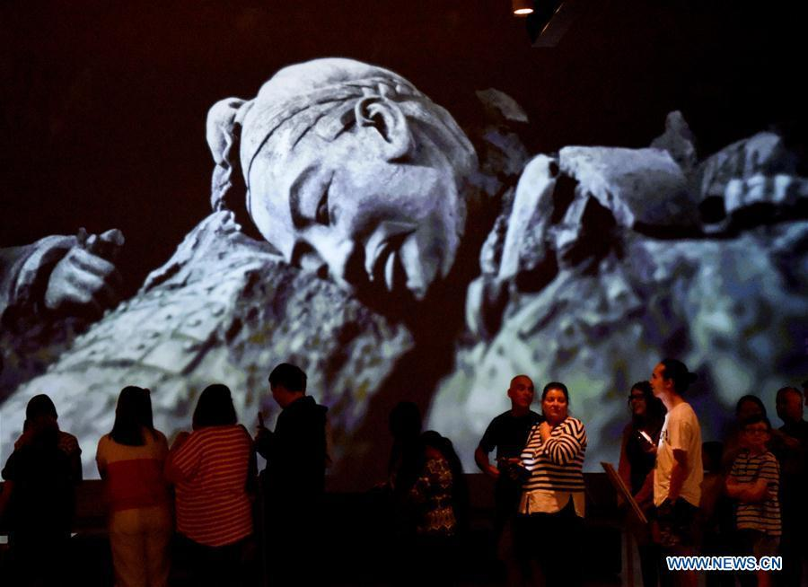 Visitors wait for entering the exhibition Terracotta Warriors: Guardians of Immortality at the National Museum of New Zealand in Wellington, New Zealand, on Dec. 15, 2018. The landmark exhibition of Terracotta Warriors: Guardians of Immortality opened to public on Saturday at the National Museum of New Zealand. The exhibition features eight warriors standing 180 cm tall, and two full-size horses from the famous terracotta army, as well as two half-size replica bronze horse-drawn chariots. Also on display are more than 160 exquisite works of ancient Chinese art made from gold, jade and bronze. \