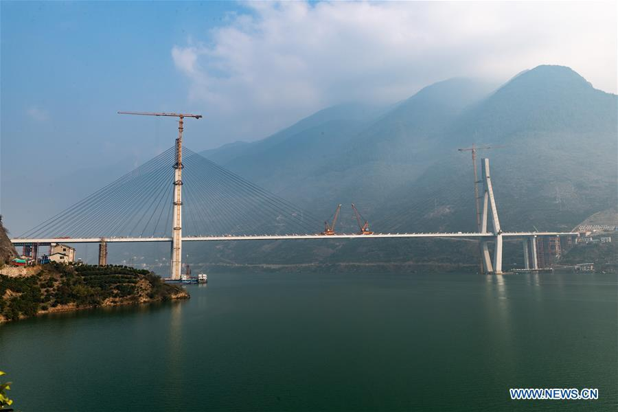 Photo taken on Dec. 16, 2018 shows the Xiangxi River Bridge in Zigui County of Yichang City, central China\'s Hubei Province. The closure of the bridge with a 470-meter main span was finished on Sunday. (Xinhua/Zheng Jiayu)