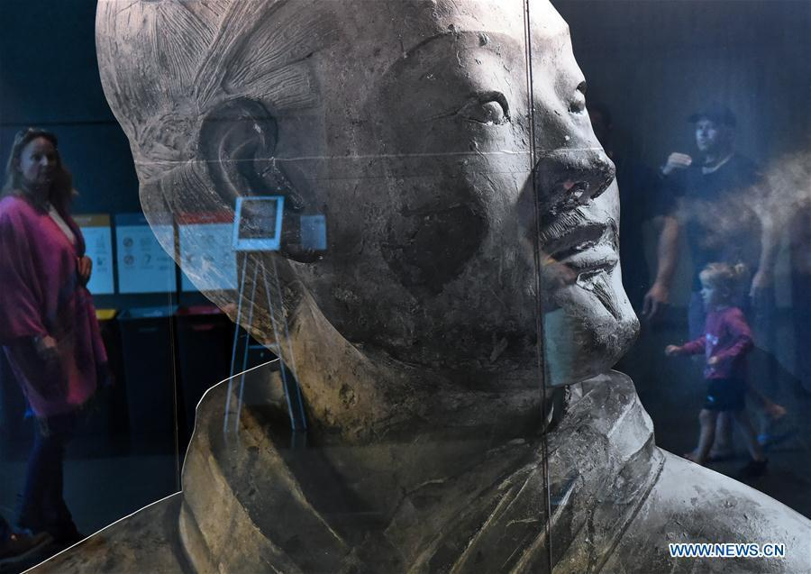 Visitors view the exhibits during the exhibition Terracotta Warriors: Guardians of Immortality at the National Museum of New Zealand in Wellington, New Zealand, on Dec. 15, 2018. The landmark exhibition of Terracotta Warriors: Guardians of Immortality opened to public on Saturday at the National Museum of New Zealand. The exhibition features eight warriors standing 180 cm tall, and two full-size horses from the famous terracotta army, as well as two half-size replica bronze horse-drawn chariots. Also on display are more than 160 exquisite works of ancient Chinese art made from gold, jade and bronze. \