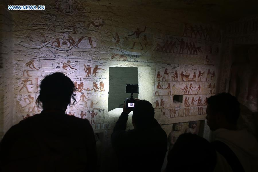 People visit a tomb in Saqqara Necropolis in Giza, Egypt, Dec. 15, 2018. Egyptian Antiquities Minister Khaled al-Anany announced Saturday the discovery of an \