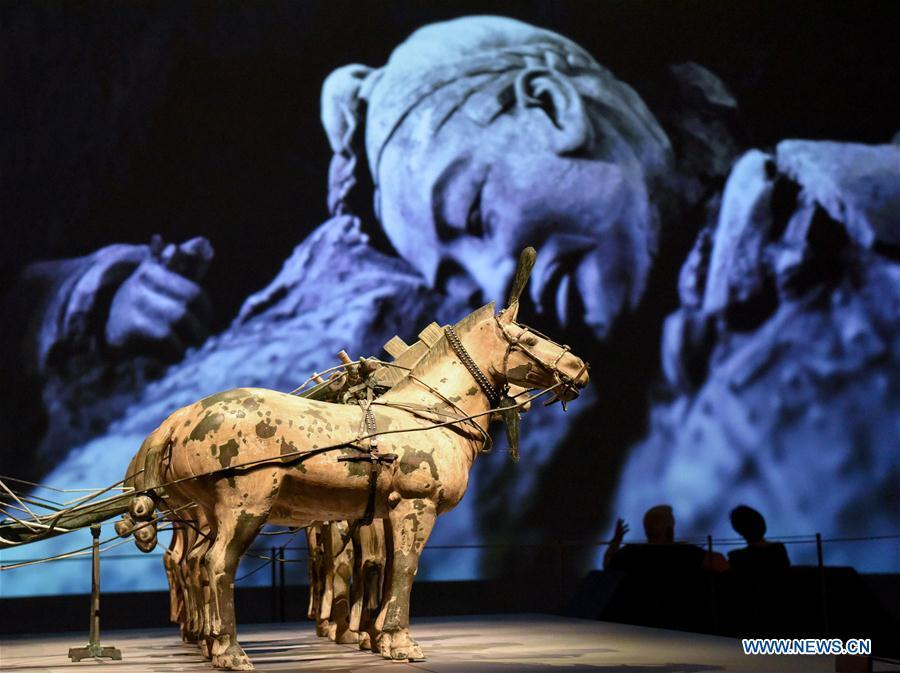 The exhibition Terracotta Warriors: Guardians of Immortality is held at the National Museum of New Zealand in Wellington, New Zealand, on Dec. 15, 2018. The landmark exhibition of Terracotta Warriors: Guardians of Immortality opened to public on Saturday at the National Museum of New Zealand. The exhibition features eight warriors standing 180 cm tall, and two full-size horses from the famous terracotta army, as well as two half-size replica bronze horse-drawn chariots. Also on display are more than 160 exquisite works of ancient Chinese art made from gold, jade and bronze. \