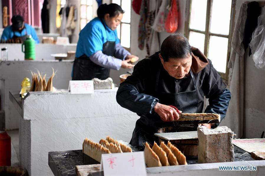 Workers make the Xuan ink brushes at a workshop in Huangcun Town of Jingxian County, east China\'s Anhui Province, Dec. 14, 2018. Huangcun Town has a long history of the Xuan ink brush making. The ink brush, ink, Chinese Xuan paper and ink slabs are four traditional writing materials of Chinese stationery. (Xinhua/Liu Junxi)