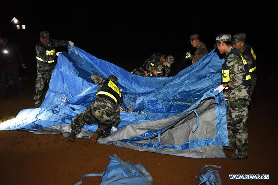 Rescuers set up makeshift tents in Zhoujia Township after a 5.7 magnitude earthquake hit Xingwen County, southwest China\'s Sichuan Province, Dec. 16, 2018. China\'s emergency regulator on Sunday initiated a national emergency response to a magnitude 5.7 earthquake in southwest China\'s Sichuan Province. The earthquake hit the county of Xingwen in the city of Yibin, Sichuan Province, at 12:46 p.m. Sunday, with a depth of 12 km, according to the local government. By 5:30 p.m. Sunday, 16 people had been reported injured in the earthquake, the ministry said. (Xinhua/Zhang Kefan)