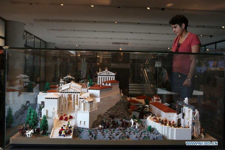 A visitor looks at the Acropolis maquette made with Lego bricks at the Acropolis Museum in Athens, Greece, on Dec. 17, 2018. The Acropolis maquette is a donation from the Nicholson Museum of Sydney. (Xinhua/Marios Lolos)