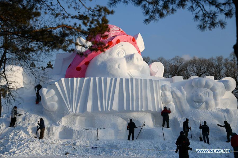 Sculptors carve a snow sculpture with \