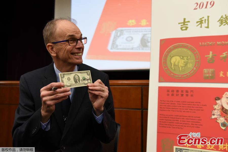 The Year of the Pig 2019 dollar bill in honor of the Chinese Lunar New Year is introduced at the Bureau of Engraving and Printing in Washington, DC, on December 17, 2018. (Photo: China News Service/Chen Mengtong)