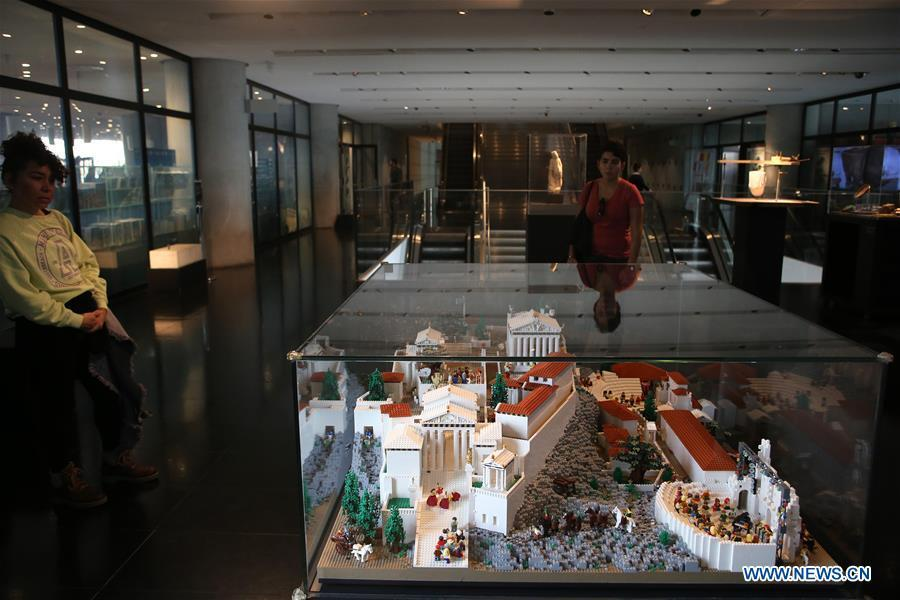 Visitors look at the Acropolis maquette made with Lego bricks at the Acropolis Museum in Athens, Greece, on Dec. 17, 2018. The Acropolis maquette is a donation from the Nicholson Museum of Sydney. (Xinhua/Marios Lolos)