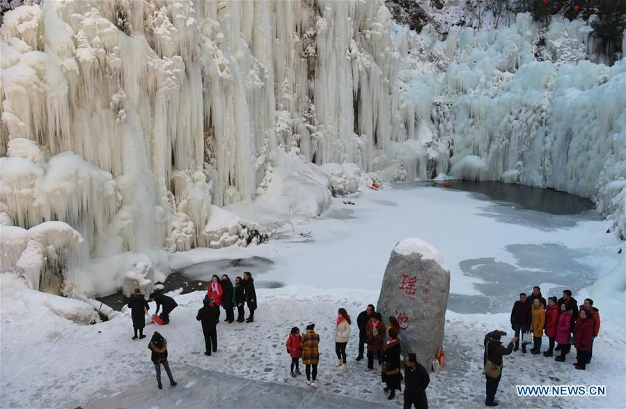 Tourists admire icicles at Dadunxia scenic spot in Linxia Hui Autonomous Prefecture, northwest China\'s Gansu Province, Dec. 16, 2018. (Xinhua/Shi Youdong)