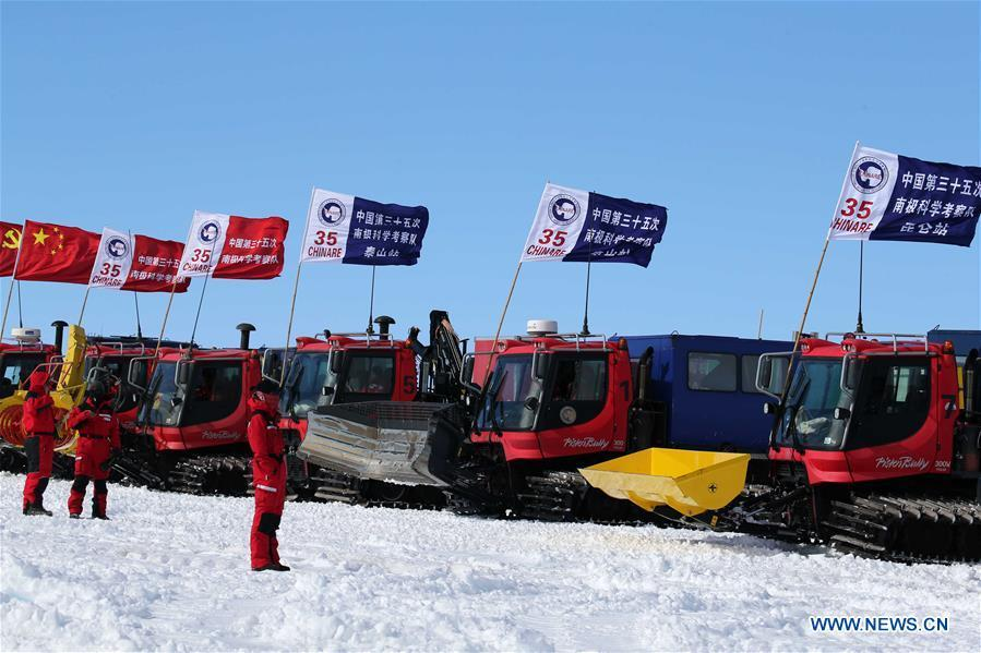 Chinese researchers wait to leave by snowmobile in Antarctica Dec. 18, 2018. China\'s 35th Antarctic expedition on Tuesday sent 37 members of two inland expedition teams to the Kunlun and Taishan stations. (Xinhua/Liu Shiping)
