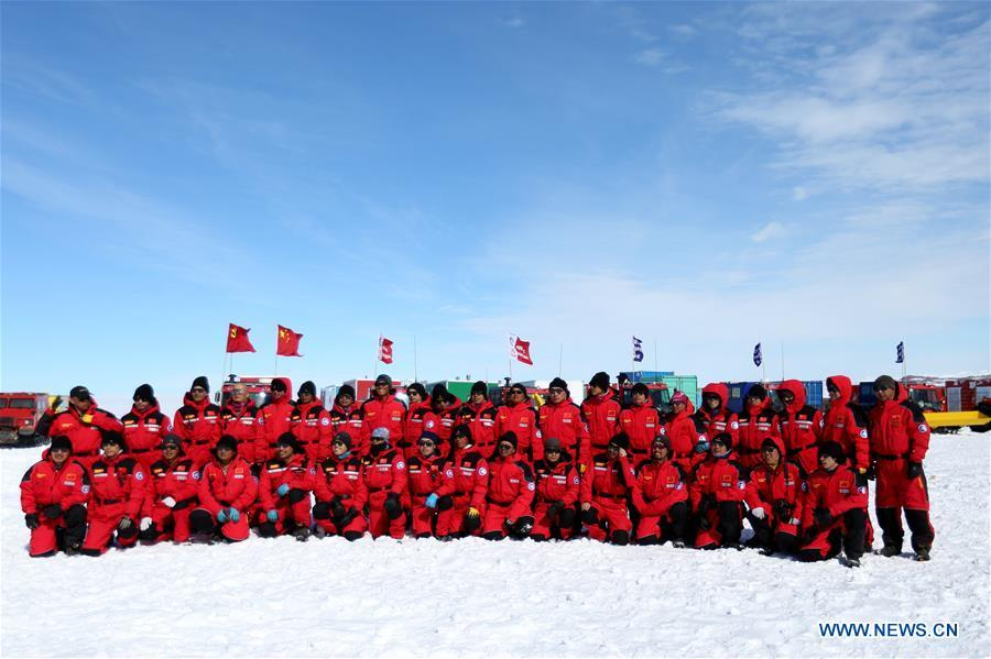 Thirty-seven Chinese researchers pose for photos before departing for China\'s Kunlun and Taishan stations in Antarctica Dec. 18, 2018. China\'s 35th Antarctic expedition on Tuesday sent 37 members of two inland expedition teams to the Kunlun and Taishan stations. (Xinhua/Liu Shiping)