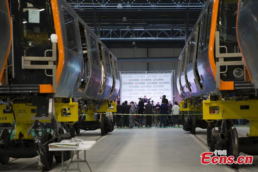 CRRC, a leading manufacturer of locomotives and rolling stock in China, rolls out the first train from its factory in Springfield, Massachusetts, the United States. The Chinese company supplies trains to the Massachusetts state transportation authority for use on Boston\'s Red and Orange subway lines. (Photo: China News Service/Liao Pan)