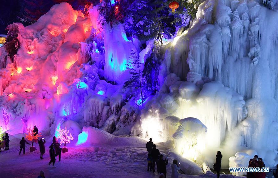 Tourists admire icicles at Dadunxia scenic spot in Linxia Hui Autonomous Prefecture, northwest China\'s Gansu Province, Dec. 16, 2018. (Xinhua/Shi Youdong)
