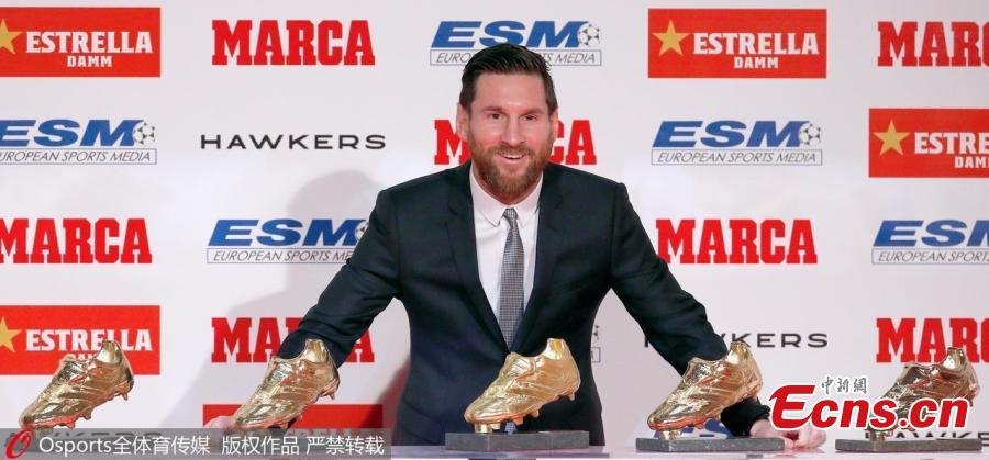 FC Barcelona\'s Lionel Messi poses with his five European Golden Shoe awards in Barcelona, Spain, Dec. 18, 2018.  (Photo/Osports)