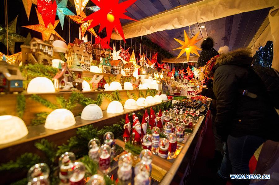 People visit a Christmas market in Hamburg, Germany, Dec. 18, 2018. There are more than 10 Christmas markets in Hamburg at present, making it a famous winter tourist city in Germany. (Xinhua/Lian Zhen)