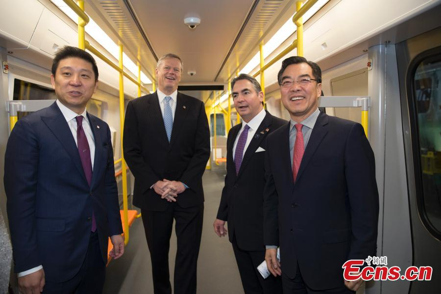 (L-R) CRRC MA President Jia Bao, Massachusetts Governor Charlie Baker, Springfield Mayor Domenic Sarno and Chinese Consulate-General in New York Huang Ping attend a ceremony to mark the first train by the CRRC factory in Springfield, Massachusetts, the United States. (Photo: China News Service/Liao Pan)