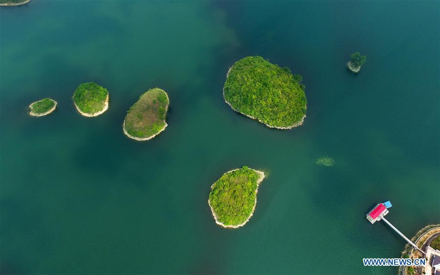 Aerial photo taken on May 17, 2018 shows the scenery of Aha wetland park in southwest China\'s Guizhou Province. Colors make our world bright and beautiful. In 2018, Xinhua photographers across China explored views from the sky with drones. Here are these drone photos with amazing colors. (Xinhua/Qin Gang)