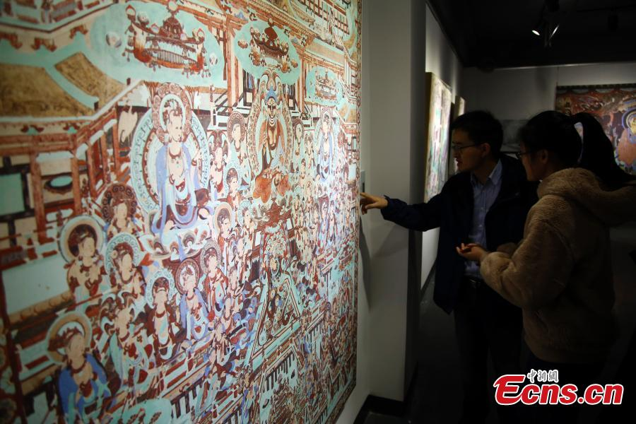 An exhibition of Dunhuang art masterpieces in Shanghai, Dec. 20, 2018. The non-profit exhibition tour at universities brought 66 large-size digital high-definition murals from the Mogao Caves. (Photo: China News Service/Tang Yanjun)