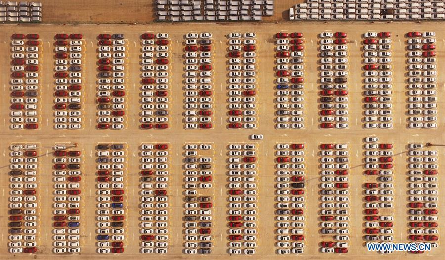 Cars are seen at Guoyuan Port in Chongqing Municipality, southwest China, Aug. 20, 2018. Colors make our world bright and beautiful. In 2018, Xinhua photographers across China explored views from the sky with drones. Here are these drone photos with amazing colors. (Xinhua/Wang Quanchao)