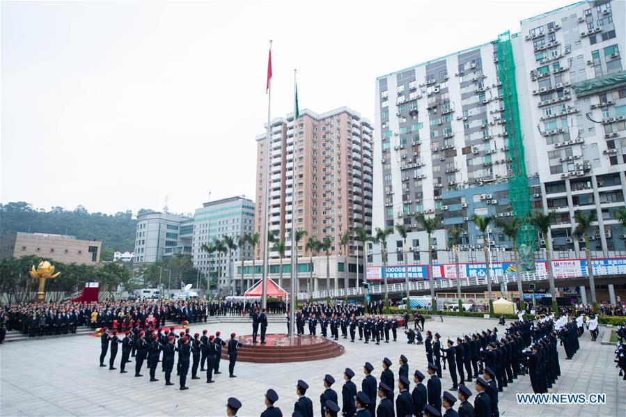 A flag-raising ceremony is held to celebrate the 19th anniversary of Macao\'s return to the motherland in Macao, south China, Dec. 20, 2018. (Xinhua/Cheong Kam Ka)