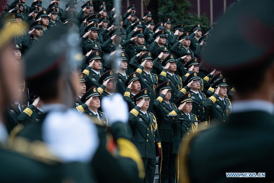 The Macao garrison of the Chinese People\'s Liberation Army (PLA) holds a flag-raising ceremony to celebrate the 19th anniversary of Macao\'s return to the motherland in Macao, south China, Dec. 20, 2018. (Xinhua/Cheong Kam Ka)