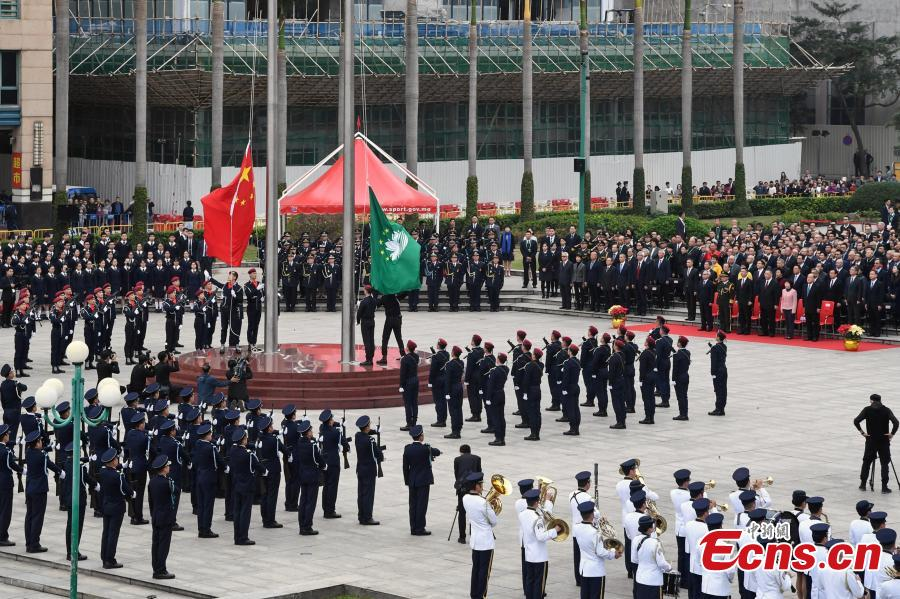 A flag-raising ceremony is held to celebrate the 19th anniversary of Macao\'s return to the motherland in Macao, south China, Dec. 20, 2018.