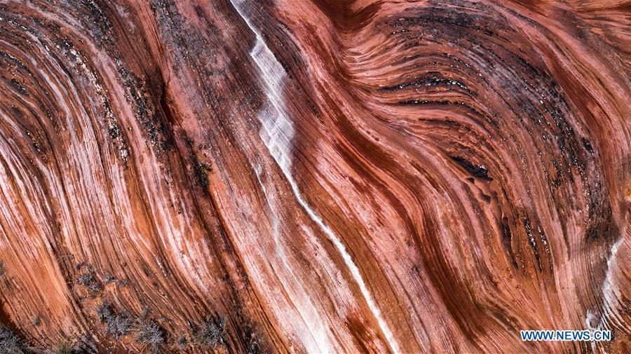 Aerial photo taken on Oct. 21, 2018 shows a view of Danxia landform at Wangjiawan of Pingqiao Town in Ansai District of Yan\'an, northwest China\'s Shaanxi Province. Colors make our world bright and beautiful. In 2018, Xinhua photographers across China explored views from the sky with drones. Here are these drone photos with amazing colors. (Xinhua/Tao Ming)