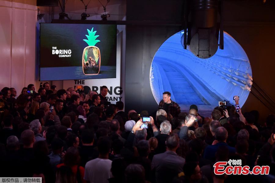 Elon Musk, co-founder and chief executive officer of Tesla Inc., walks into the crowd during an unveiling event for the Boring Company Hawthorne test tunnel in Hawthorne, California, U.S., Dec. 18, 2018. Musk unveiled his underground transportation tunnel on Tuesday, allowing reporters and invited guests to take some of the first rides in the revolutionary albeit bumpy subterranean tube — the tech entrepreneur\'s answer to what he calls \