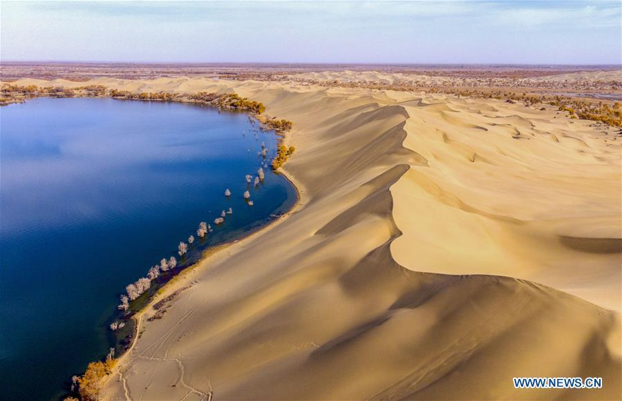 Aerial photo shows the scenery of Lop lake and Taklimakan Desert in Yuli County, northwest China\'s Xinjiang Uygur Autonomous Region, Oct. 30, 2018. Colors make our world bright and beautiful. In 2018, Xinhua photographers across China explored views from the sky with drones. Here are these drone photos with amazing colors. (Xinhua/Li Fei)