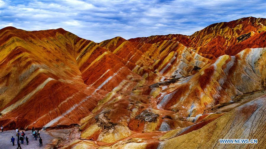 Aerial photo taken on Sept. 5, 2018 shows people visiting the Danxia National Geological Park in Zhangye, northwest China\'s Gansu Province. Colors make our world bright and beautiful. In 2018, Xinhua photographers across China explored views from the sky with drones. Here are these drone photos with amazing colors. (Xinhua/Tao Ming)