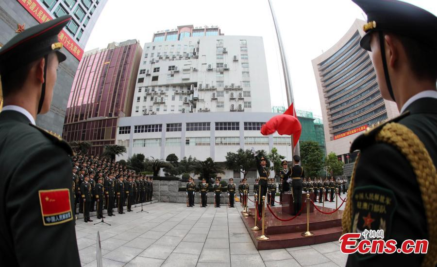 The Macao garrison of the Chinese People\'s Liberation Army (PLA) holds a flag-raising ceremony to celebrate the 19th anniversary of Macao\'s return to the motherland in Macao, south China, Dec. 20, 2018.