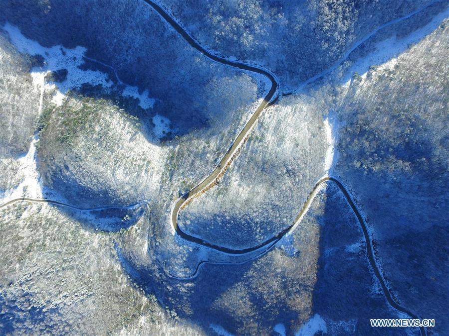 Aerial photo taken on Nov. 18, 2018 shows snow scenery at Dashui forest in Longping Town, Baokang County, central China\'s Hubei Province. Colors make our world bright and beautiful. In 2018, Xinhua photographers across China explored views from the sky with drones. Here are these drone photos with amazing colors. (Xinhua/Yang Tao)
