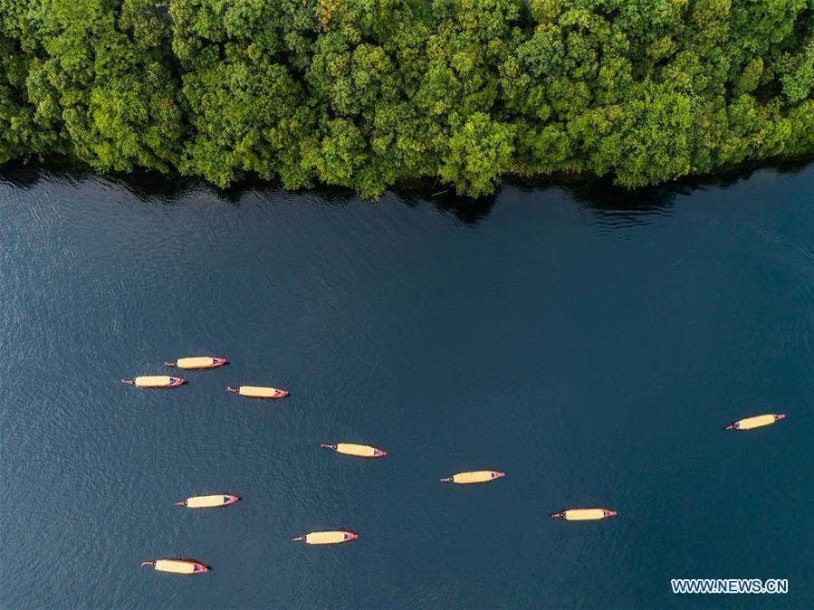Sightseeing boats are seen on Xin\'an River Jiande section in east China\'s Zhejiang Province, July 23, 2018. Colors make our world bright and beautiful. In 2018, Xinhua photographers across China explored views from the sky with drones. Here are these drone photos with amazing colors. (Xinhua/Xu Yu)