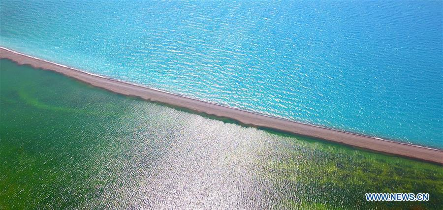 Aerial photo taken on July 18, 2018 shows the scenery of the Sayram Lake in northwest China\'s Xinjiang Uygur Autonomous Region. Colors make our world bright and beautiful. In 2018, Xinhua photographers across China explored views from the sky with drones. Here are these drone photos with amazing colors. (Xinhua/Xu Congjun)