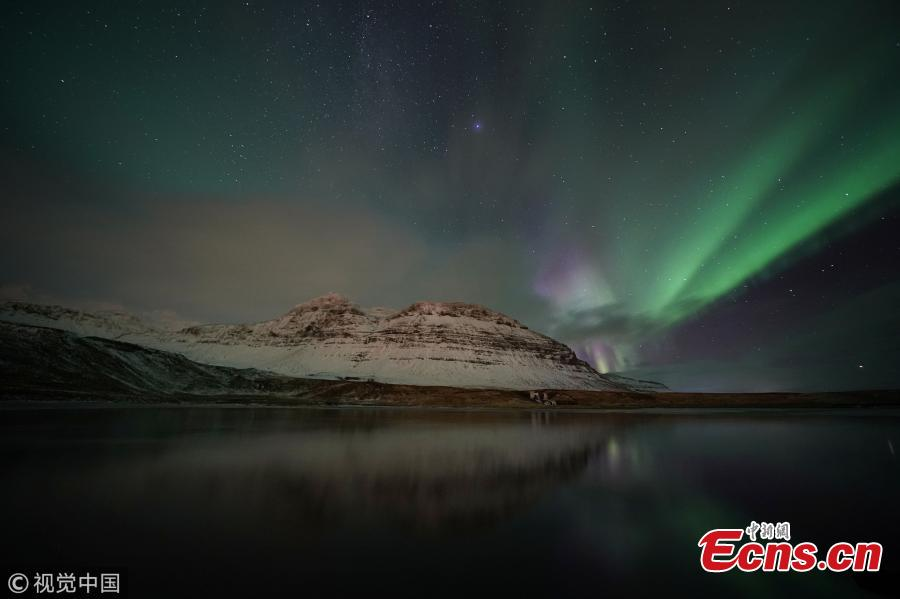 Aurora Borealis, the Northern Lights, over Kirkjufell, a 463 meter mountain on the west coast of Iceland. (Photo by Owen Humphreys/PA Images via Getty Images)