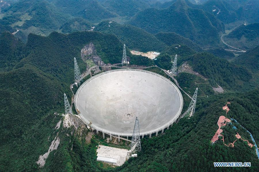 Photo taken on Sept. 10, 2018 shows China\'s Five-hundred-meter Aperture Spherical Radio Telescope (FAST) in southwest China\'s Guizhou Province. The living and working scenes of Chinese people in the past year have created a series of amazing views, some of which formed geometric figures. Those photos tell the development and progress of the country in 2018. (Xinhua/Ou Dongqu)